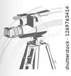 black camera with tripod on a... | Shutterstock .eps vector #1269763414