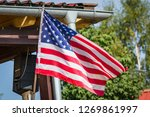 American Flag On A Porch...