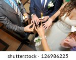 priest's hands holding golden... | Shutterstock . vector #126986225