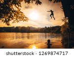 man jumping to the water in... | Shutterstock . vector #1269874717