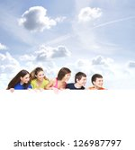 group of teenagers with a giant ... | Shutterstock . vector #126987797