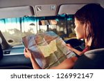 woman on vacation looking at... | Shutterstock . vector #126992147