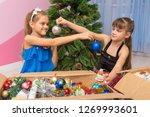 sisters show each other... | Shutterstock . vector #1269993601