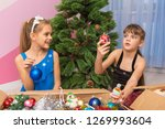 two girls pull christmas toys... | Shutterstock . vector #1269993604