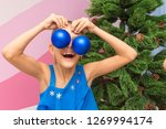 the girl put big christmas... | Shutterstock . vector #1269994174
