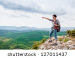 girl standing on a mountain and ... | Shutterstock . vector #127011437