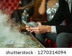 man with cigar counting money... | Shutterstock . vector #1270314094