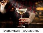 barman sprinkling bitter on the ... | Shutterstock . vector #1270322287
