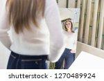 a beautiful woman shopping in a ...   Shutterstock . vector #1270489924