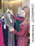 a beautiful woman shopping in a ...   Shutterstock . vector #1270489927