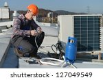 air conditioning repair  young ... | Shutterstock . vector #127049549