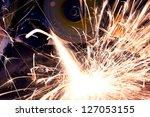 worker cutting metal using... | Shutterstock . vector #127053155