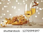 golden gift box with glasses of ... | Shutterstock . vector #1270599397