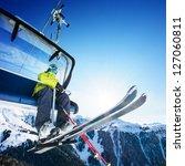 Skier Sitting At Ski Lift In...