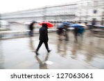 motion blur picture of walking people on the St. Mark's Square in Venice on a rainy day - stock photo