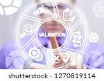 Stock photo validation business concept man pushing a validation word button on a virtual round interface 1270819114