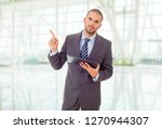 young businessman working with...   Shutterstock . vector #1270944307