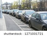 cars parked in a row on a city... | Shutterstock . vector #1271031721