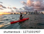 Adventurous Girl Kayaking In...