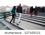 people in motion blur walking on the pedestrian bridge Ponte dell Accademia in Venice - stock photo