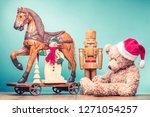 retro teddy bear in santa's hat ...   Shutterstock . vector #1271054257