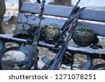 Bucharest, Romania - December 1, 2018: Polish Beryl 5.56×45mm NATO assault rifles with holographic sights, vertical foregrips and bayonets lay on the ground with other army objects - stock photo