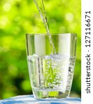 glass of water on nature... | Shutterstock . vector #127116671