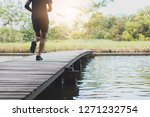 close up legs of man running... | Shutterstock . vector #1271232754