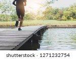 close up legs of man running... | Shutterstock . vector #1271232754