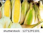 fresh raw corn cob on corn...   Shutterstock . vector #1271291101