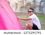 an asian man in white t shirt...   Shutterstock . vector #1271291791