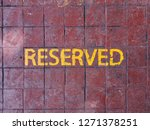 reserved text on a cement tile... | Shutterstock . vector #1271378251
