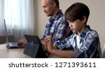 male kid playing game on tablet ... | Shutterstock . vector #1271393611