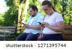 Stock photo obese young couple chatting in social networks during date shy and insecure 1271395744