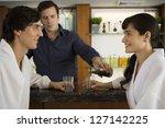 bartender serving a young... | Shutterstock . vector #127142225