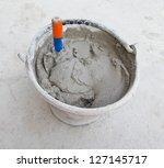 close up  trowel in cement   Shutterstock . vector #127145717