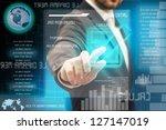 a man touching a button on a... | Shutterstock . vector #127147019