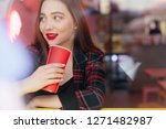woman drink her hot coffee... | Shutterstock . vector #1271482987