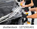 car wrapping specialist putting ... | Shutterstock . vector #1271501401