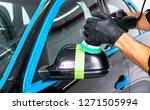 car polish wax worker hands...   Shutterstock . vector #1271505994