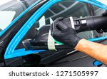 car polish wax worker hands...   Shutterstock . vector #1271505997