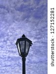 an old lamp atop a lamppost... | Shutterstock . vector #127152281