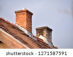 two chimneys on the house  | Shutterstock . vector #1271587591