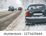 car parked at road side....   Shutterstock . vector #1271625664