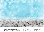 wooden table and winter snow... | Shutterstock . vector #1271734444