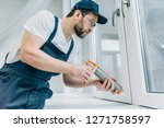 bearded adult repairman fixing... | Shutterstock . vector #1271758597