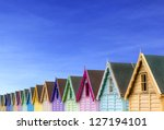Row Of Beach Huts With A Deep...