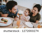 girl gives father sandwich.... | Shutterstock . vector #1272003274