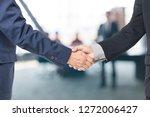 two handsome businessmen... | Shutterstock . vector #1272006427