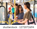two girls standing in a bus... | Shutterstock . vector #1272072694